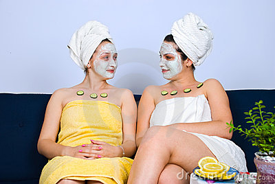 Two women with facial mask at spa salon