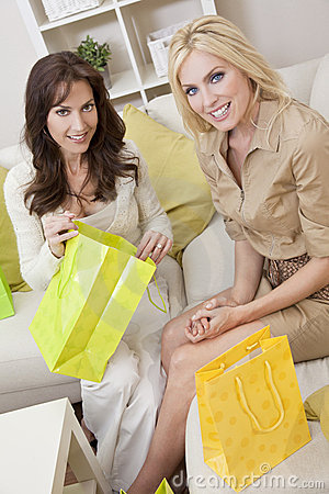 Two Women Friends With Shopping Bags at Home Home