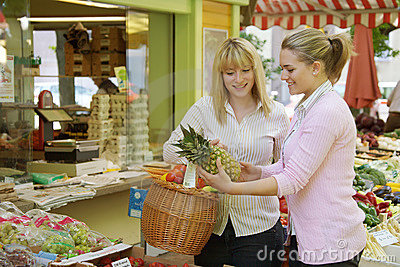Two women on the fruit market