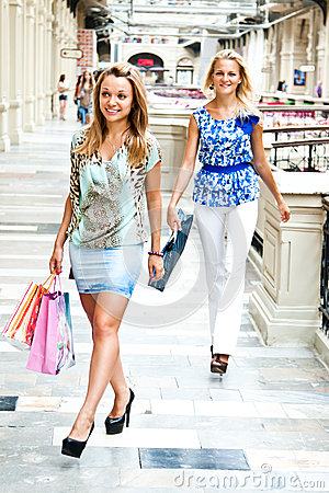 The two women go shopping in a mall
