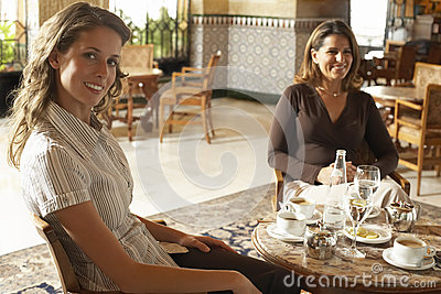 Two Women Having Drinks In Restaurant