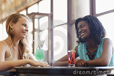 Two women having fun in pub