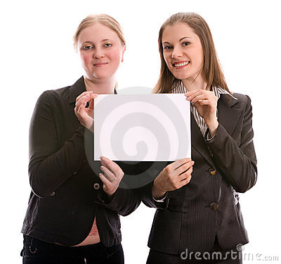 Two women holding a blank card. Isolated on white