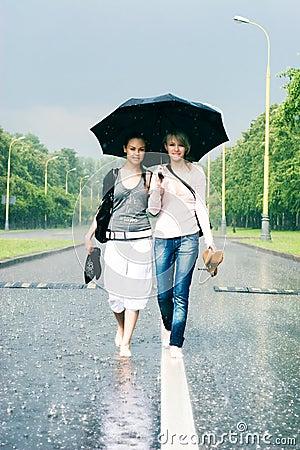 Free Two Women In A Heavy Rain Stock Photos - 5829923