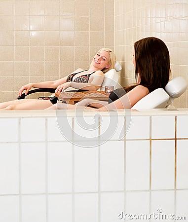 Two Women Beside Indoor Pool
