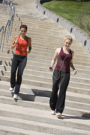 Free Two Women Jogging Down Steps Royalty Free Stock Photos - 5400728