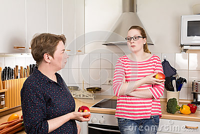 Two women kitchen bad mood