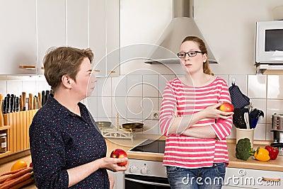 Two women kitchen bad mood