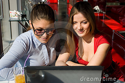 Two women with laptop