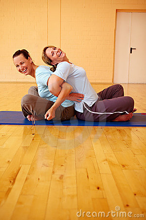 Two women laughing in gym