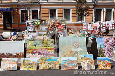 Two women looking for paintings on sale Editorial Photography