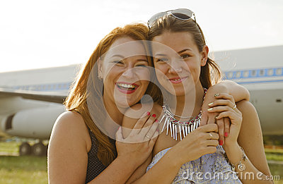 Two women mother and daughter met at the airport after trip