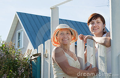 Two   women near fence wicket