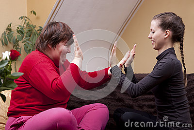 Two women making rhythm exercises