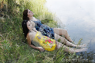 Two Women Outdoors River Dresses Feet In Water