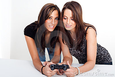 Two women, playing video games