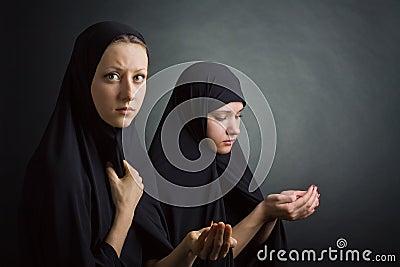 Two women pray