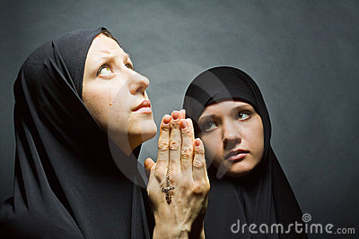 Two women pray