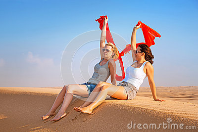 Two women in the sandy desert
