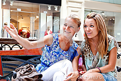 Two women in a shopping center