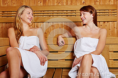 Two women sitting in sauna