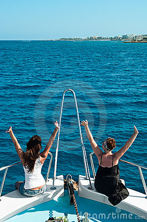 Two women on stern of yacht