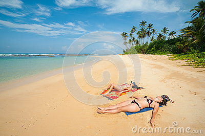 Two women sunbathing