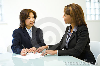 Two women talking business