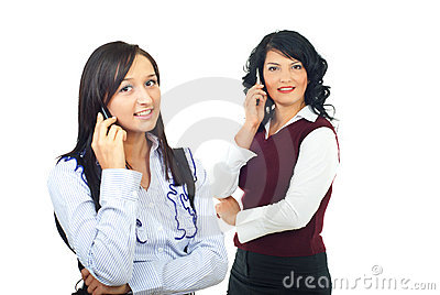Two women talking by cell phones