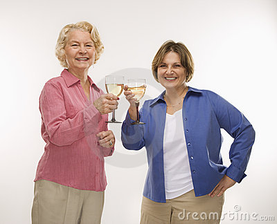 Two women toasting wine.
