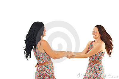 Two women twirl together