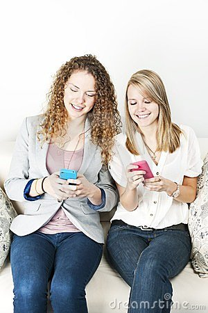 Two women using mobile devices