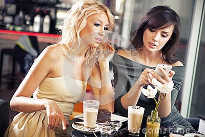 Two women using a smartphone