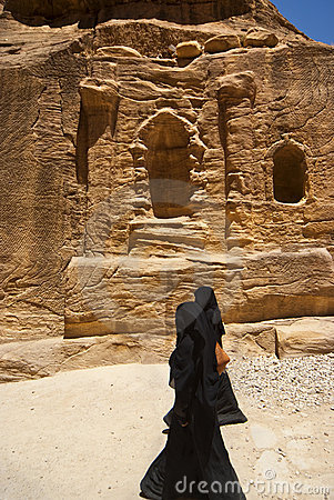 Two women with the veil niqab walking in Petra Editorial Photography