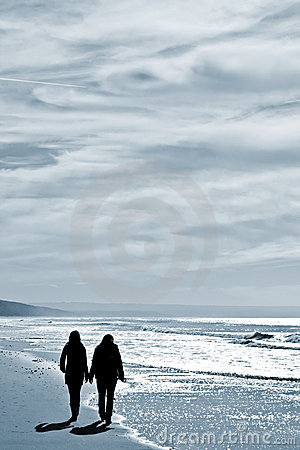 Two women walking at the beach