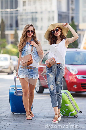 Free Two Women With Suitcases On The Way To The Airport Royalty Free Stock Images - 59809969