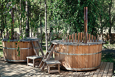 Two wooden bathtubs