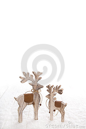 Free Two Wooden Carved Moose Isolated On White Snowy Background For C Royalty Free Stock Photo - 60884715