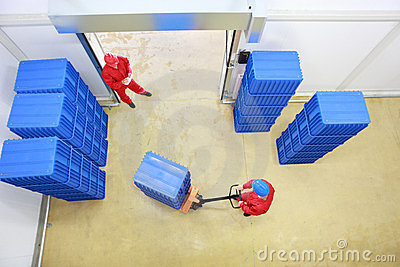 Two workers preparing goods delivery
