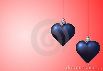Two xmas hearts on red