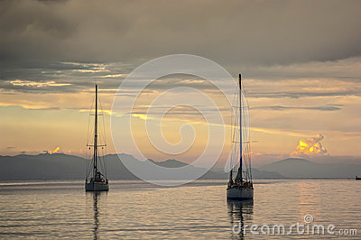 Two yachts enter Rhodes port at sunset