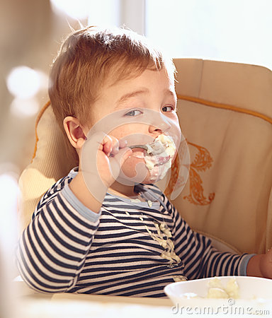 Free Two Year Old Boy Eats Porridge In The Morning. Stock Photography - 29355552