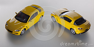 Two yellow toy cars