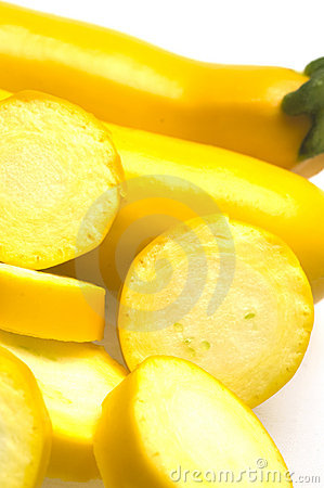 Two yellow zucchini squash with slices