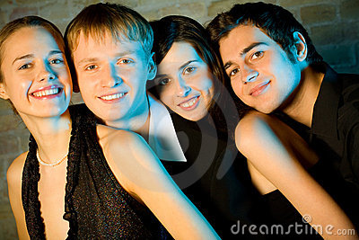 Two young attractive smiling couples or friends at a Party