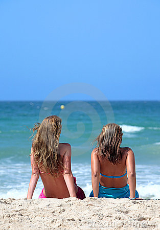 Free Two Young Attractive Women Chilling In The Sun On Holiday Or Vac Royalty Free Stock Photo - 1856345