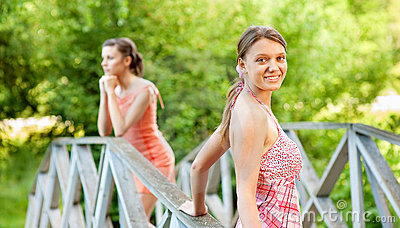 Two young and beautiful girls at banisters