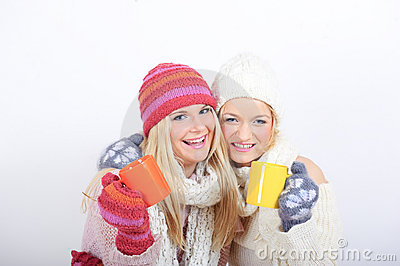 Two Young beautiful winter girls with tea cup