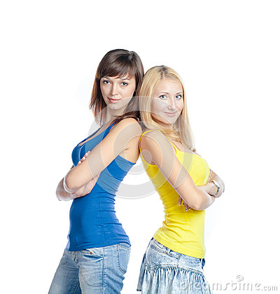 Two young beautiful woman on white