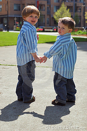Free Two Young Brothers - Holding Hands Royalty Free Stock Images - 5251999